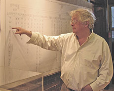 Stephen Rintoul Davenport III, Honorary Chairman of the exhibit, points to his family branch on the Davenport Genealogy Chart.