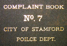 text on cover of police complaint book, note typo
