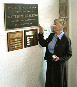 Mrs. Katherine T.S. Coley, with the plaque honoring Charlotte D.S. Cruikshank