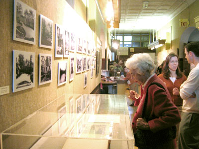 Society Member Janet Thorpe looks at the photo exhibit