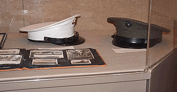 dress white hat worn by Ed Domagala, marine uniform hat worn by Chet Buttery, photo album by Ed Domagala