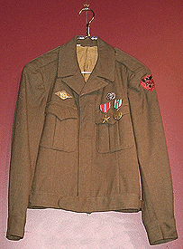 Eisenhower Jacket with Medical Combat Badge, Bronze Star Medal, European Theatre Medal with one combat star worn by George Reiss