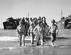 General MacArthur wades ashore in the 24th Infantry Division
