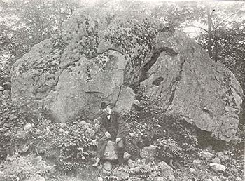 MR. BLICKENSDERFER BY HIS HUGE, LICHEN DOTTED BOULDER