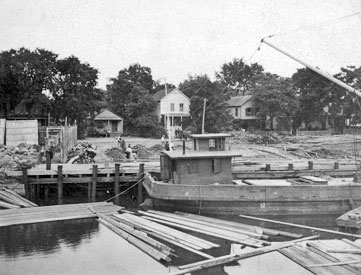 Getman & Judd lumber yard, 1898. Barge at the canal.