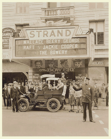 Strand Theatre c. 1933. Movie promotion of 'The Bowery'. Police officer John McInerney directing traffic.