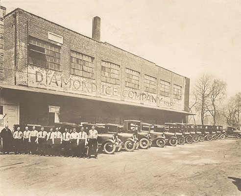 Diamond Ice Company building, employees, and delivery trucks, c. 1920