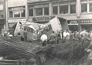 Truck smashed by a falling tree, Main Street