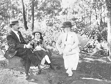 Mr. Denlap with wife and daughter in the hammock