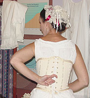 The back lacings of a corset would allow for a little space in between each side so the individual backbones would fit comfortably.