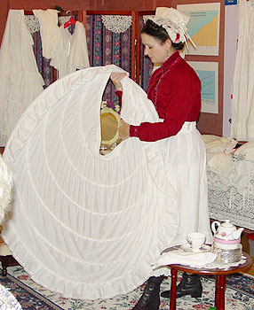 A series of hoops encased in a slip known as a crinoline supported the weight and fullness of a skirt