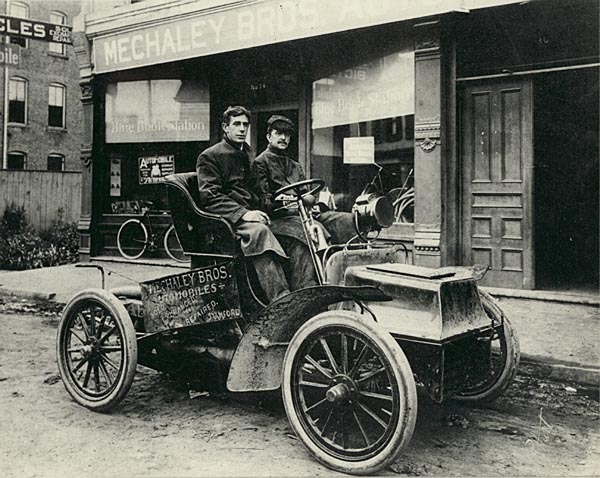 Joseph Mechaley on the left, with an unidentified gentleman, in a 1904 Cadillac