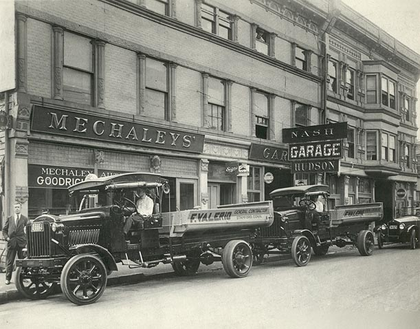 Cars lining up in front of Mechaleys for Automobile Show at the Armory, circa 1920