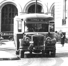 A bus. Citizens Savings Bank in the background.