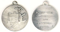 pewter pendant depicting the Hoyt Barnum House