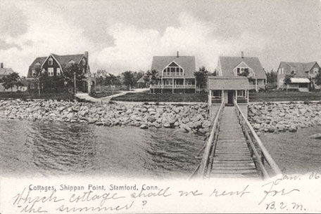 Uncancelled postcard of summer cottages dated January 6, no year given, with inscription.