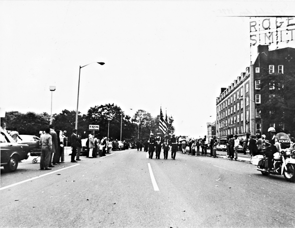 Marching down Washingotn Boulevard, at right the old Roger Smith Hotel, just south of the Broad Street intersection